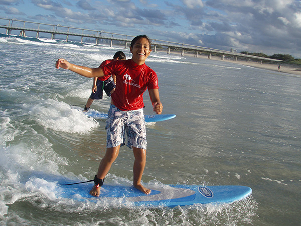 young surfer enjoying the wave