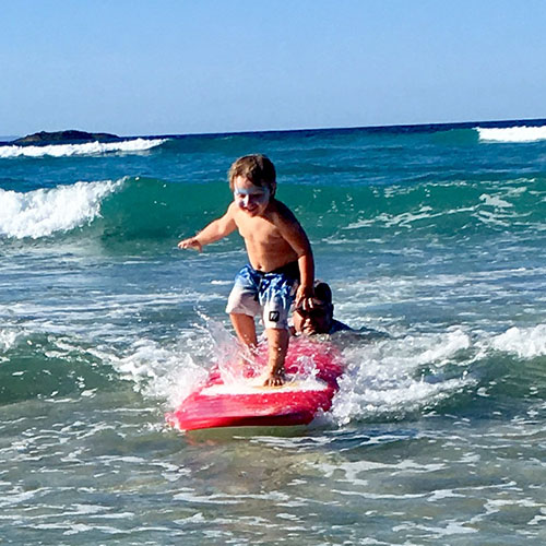 toddler learning to surf