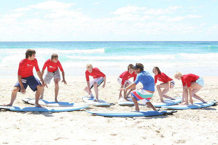 group of surfers in training
