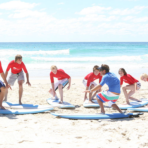 group of young surfers learning