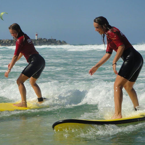 two women surfing
